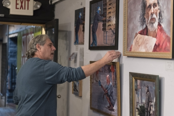 "Artist Daniel Miller labels his paintings for the art event and charity supply drive ""Third World America"" at EDEN Art Studio & Gallery inside The Arts Factory in Las Vegas Tuesday,  ..."