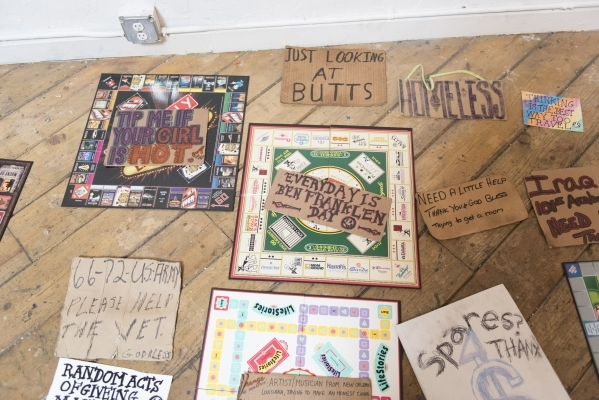 "A collection of signs for the art event and charity supply drive ""Third World America"" is seen at EDEN Art Studio & Gallery inside The Arts Factory in Las Vegas Tuesday, Dec. 8, 2015 ..."