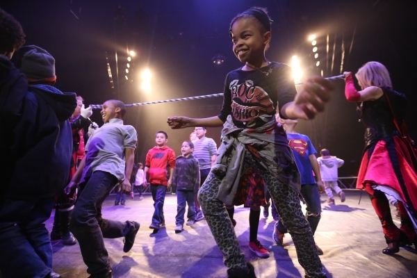 Children do the limbo during the pre-show for the opening night of Circus Vargas at the Meadows Mall parking lot in Las Vegas Thursday, Dec. 11, 2015. Rachel Aston/Las Vegas Review-Journal Follow@ ...