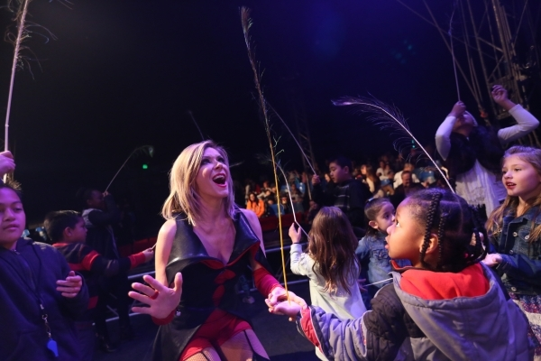 Host Laura Weiss helps children try to balance peacock feathers during the pre-show for the opening night of Circus Vargas at the Meadows Mall parking lot in Las Vegas Thursday, Dec. 11, 2015. Rac ...