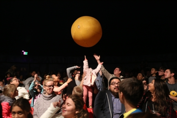The crowd tries to keep a giant ball from touching the ground during the opening night of Circus Vargas at the Meadows Mall parking lot in Las Vegas Thursday, Dec. 11, 2015. Rachel Aston/Las Vegas ...