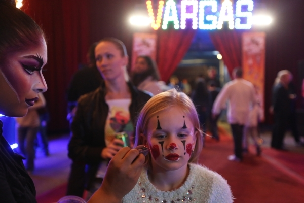 Celeste Rivera applies facepaint to Yana Golovam during intermission for the opening night of Circus Vargas at the Meadows Mall parking lot in Las Vegas Thursday, Dec. 11, 2015. Rachel Aston/Las V ...