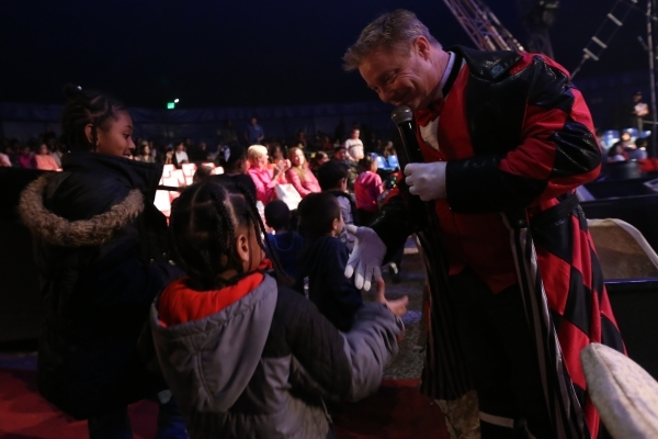 Host Jon Weiss greets children during the opening night for Circus Vargas at the Meadows Mall parking lot in Las Vegas Thursday, Dec. 11, 2015. Rachel Aston/Las Vegas Review-Journal Follow@rookie__rae
