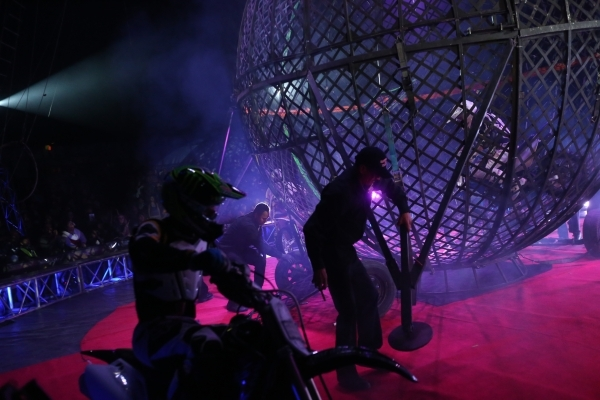 The Dominguez family drive motorcycles in a steel sphere during the opening night for Circus Vargas at the Meadows Mall parking lot in Las Vegas Thursday, Dec. 11, 2015. Rachel Aston/Las Vegas Rev ...
