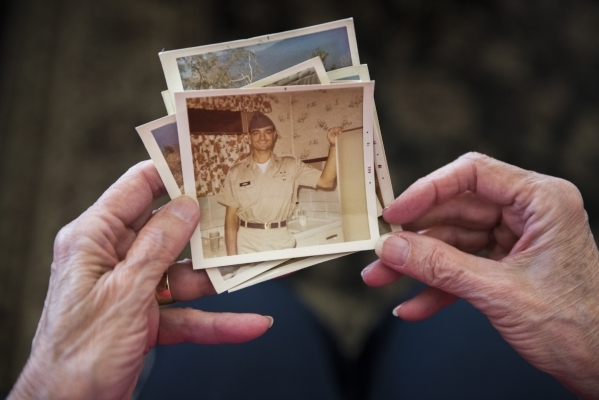 Joan Donegan, holds up photos of her younger brother, Vietnam veteran Kenneth J. Sipich, at her Las Vegas home Tuesday, Dec. 8, 2015. Donegan is helping her homeless brother find stability and hou ...