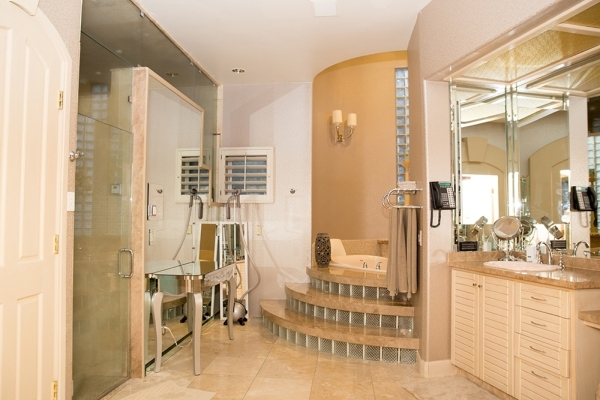 """In the master bath, Terry Fator installed a steam shower. """"It's very good for my voice,"""" he says. It has a special waterproof TV, which was necessary, he said, """"mostly for foo ..."""