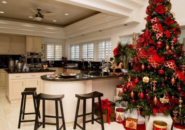 One of several Christmas trees is near the kitchen area. The kitchen is not as large and centrally focused as of those in many new luxury homes, but that didn't stop Angie Fiore, a Dallas ca ...