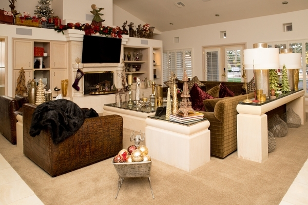 Las Vegas performer Terry Fator updated the 1973 home and installed ethernet cables to every room to facilitate his media and game hobby. The living room, which is decked out for Christmas, featur ...