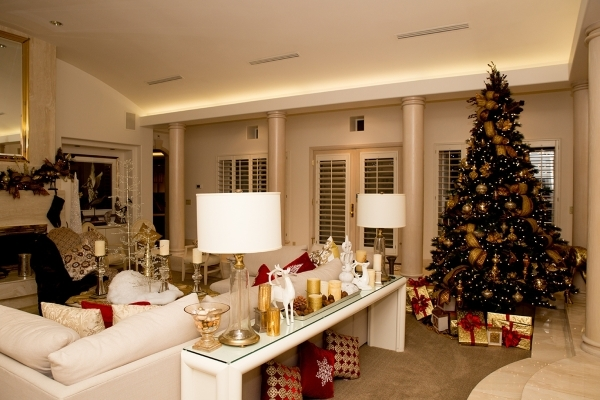 The main Christmas tree in the living room has wrapped gifts underneath.   TONYA HARVEY/REAL ESTATE MILLIONS