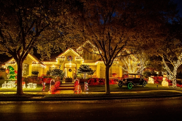 Holiday Illumination of Las Vegas sent eight installers who spent all day helping Barbara Heinrich create her antique car-themed Christmas display.   TONYA HARVEY/REAL ESTATE MILLIONS
