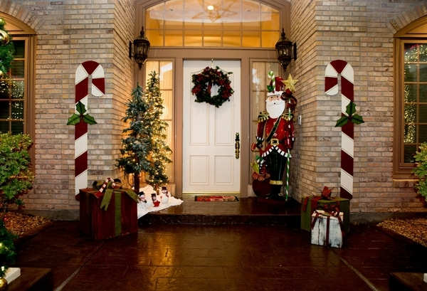 Tall candy canes are at the door of the Heinrichs'  Henderson home.   TONYA HARVEY/REAL ESTATE MILLIONS