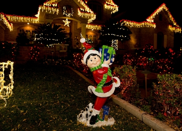 An elf stands in front of the decorated Henderson home.  TONYA HARVEY/REAL ESTATE MILLIONS