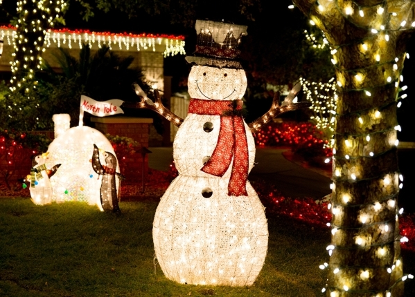 One side of the yard boasts a tall Frosty the Snowman and an igloo.   TONYA HARVEY/REAL ESTATE MILLIONS