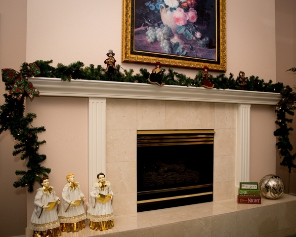 The fireplace is decked out with holly and a choir.   TONYA HARVEY/REAL ESTATE MILLIONS