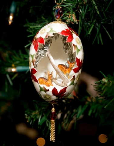 Hanging on the tree are one-of-a-kind decorations that include a goose egg carved out with tiny deer inside.  TONYA HARVEY/REAL ESTATE MILLIONS