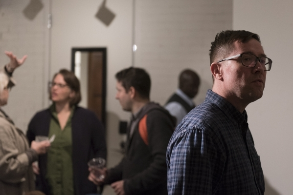 Artist Franklin Evans, right, mingles with attendees at P3 Studio in The Cosmopolitan of Las Vegas Wednesday, Dec. 9, 2015. Jason Ogulnik/Las Vegas Review-Journal