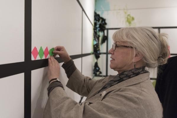 "Marilyn McIntyre adds her contribution to the ""Shelf Life"" exhibit at P3 Studio in The Cosmopolitan of Las Vegas in Las Vegas Wednesday, Dec. 9, 2015. Jason Ogulnik/Las Vegas Review-Journal"