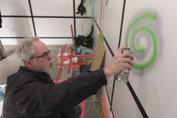 "Martin Hackett adds his contribution to the ""Shelf Life"" exhibit at P3 Studio in The Cosmopolitan of Las Vegas in Las Vegas Wednesday, Dec. 9, 2015. Jason Ogulnik/Las Vegas Review-Journal"