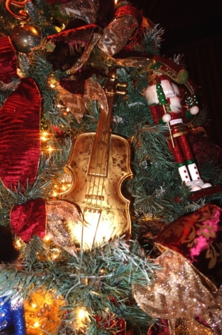 The Bootlegger Bistro is also a musical venue, so its tree includes a violin as a tree decoration. COURTESY DIANE TAYLOR