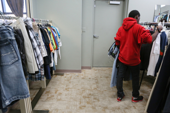 A young man shops during a teen shopping day at Project 150 on Saturday, Dec. 12, 2015, in Las Vegas. Project 150 is a nonprofit that allows homeless and displaced high school students to shop for ...