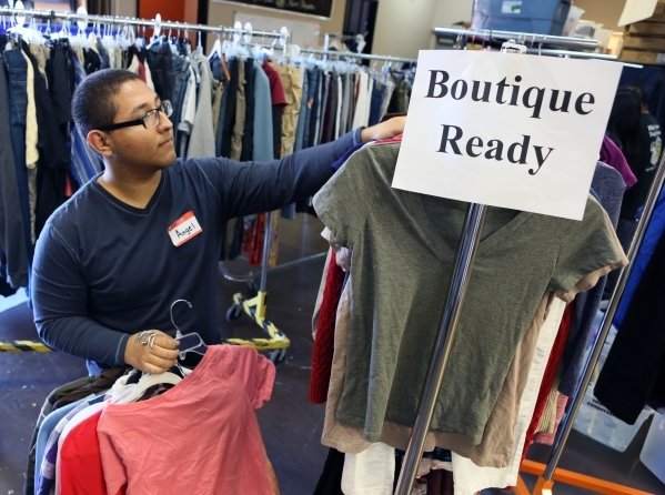 Volunteer Angel Reynosa sorts clothing during a teen shopping day at Project 150 on Saturday, Dec. 12, 2015, in Las Vegas. Project 150 is a nonprofit that allows homeless and displaced high school ...