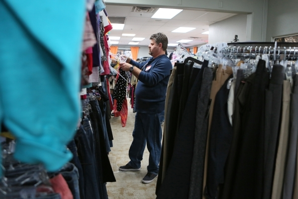 Volunteer Paul Beauchamp hangs clothing during a teen shopping day at Project 150 on Saturday, Dec. 12, 2015, in Las Vegas. Project 150 is a nonprofit that allows homeless and displaced high schoo ...