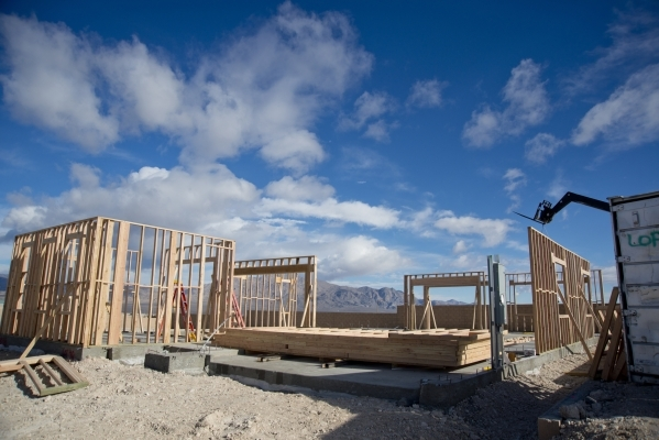 The wood frame of a home is seen inside the Teton Cliffs subdivision of the Skye Canyon master-planned community just off U.S. Highway 95 at Skye Canyon Drive in northwest Las Vegas on Monday, Dec ...
