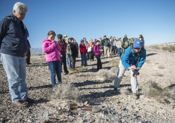 Hikers look over a pile of debris that was left behind by an archeological dig in 1962 at the Tule Springs Fossil Beds National Monument Nov. 11. Jacob Kepler/View file photo