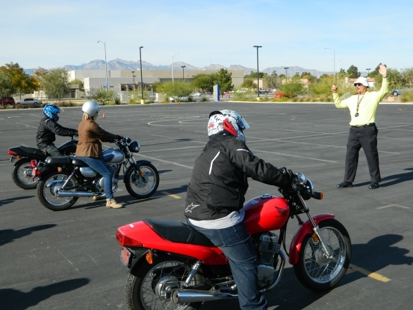 "Mike ""Pilot"" Nelson, right, instructs motorcycle students participating in  the College of Southern Nevada's Basic Rider I class Dec. 5 at the Charleston campus, 6375 W. Charleston ..."