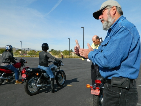 Roger Fox, right, coordinator of CSN's motorcycle programs, speaks with students during a Basic Rider I class Dec. 5 at the Charleston campus, 6375 W. Charleston Blvd. Cassandra Keenan/View
