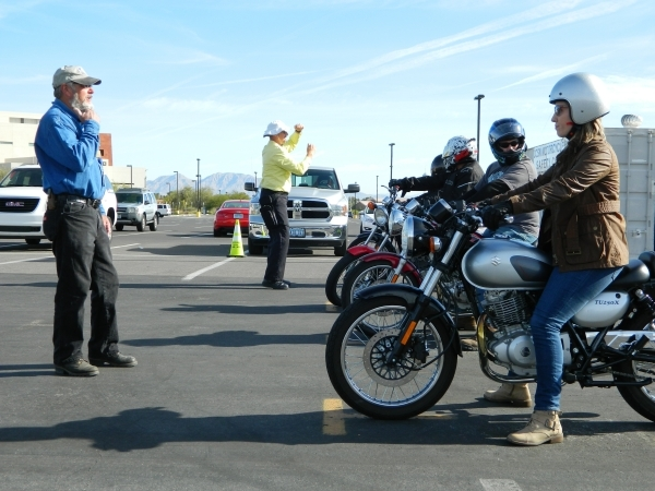 Roger Fox, left, coordinator of CSN's motorcycle programs, speaks with students during a Basic Rider I class Dec. 5 at the Charleston campus, 6375 W. Charleston Blvd. Cassandra Keenan/View