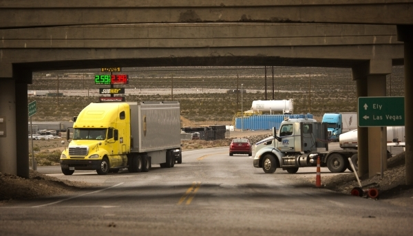 Trucks are seen at the Apex exit at U.S. 93 highway and Interstate-15 on Wednesday, Dec. 09, 2015. Gov. Brian Sandoval will announce Thursday in Las Vegas that the electric car maker Faraday Futur ...