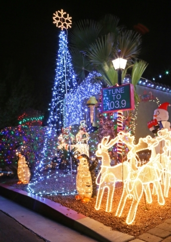 christmas lights are shown on a home sunday dec 13 2015 in - Las Vegas Christmas Decorations