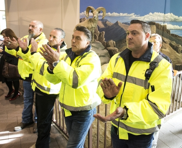 Members of Laborers Local 872 clap during the Faraday Future  development announcement  at the Sawyer Building on Thursday, Dec. 10, 2015. The auto manufacturing company is scheduled to build a $1 ...