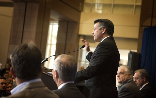 Gov. Brian Sandoval  speaks during the Faraday Future  development announcement  at the Sawyer Building on Thursday, Dec. 10, 2015. The auto manufacturing company is scheduled to build a $1 billio ...