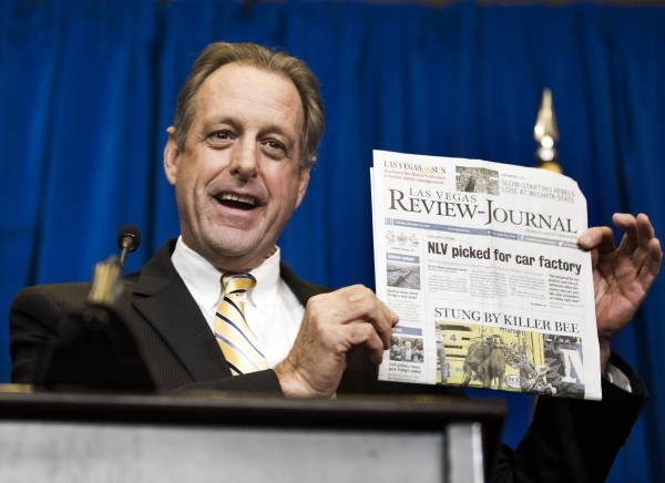 North Las Vegas Mayor John Lee holds a copy of the Las Vegas Review-Journal during Faraday Future announcement  at the Sawyer Building on Thursday, Dec. 10, 2015. The auto manufacturing company is ...
