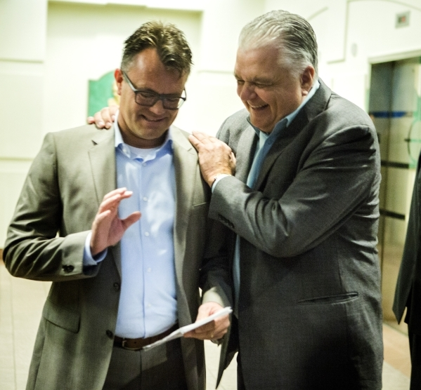 Clark County Commissioner Steve Sisolak, right, andDag Reckhorn, global vice president for Faraday Future share a laugh during the Faraday's  development announcement  at the Sawyer Building ...