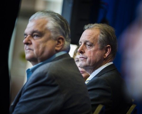 Clark County Commissioner Steve Sisolak, left, and North Las Vegas Mayor John Lee listens while Gov. Brian Sandoval speaks during the Faraday's  development announcement  at the Sawyer Build ...