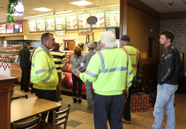 People lined up to buy sandwiches from Subway inside Love's Travel Stop at 12501 Apex Great Basin Way on Thursday, Dec. 10, 2015, near the site where Chinese-backed electric carmaker Faraday ...