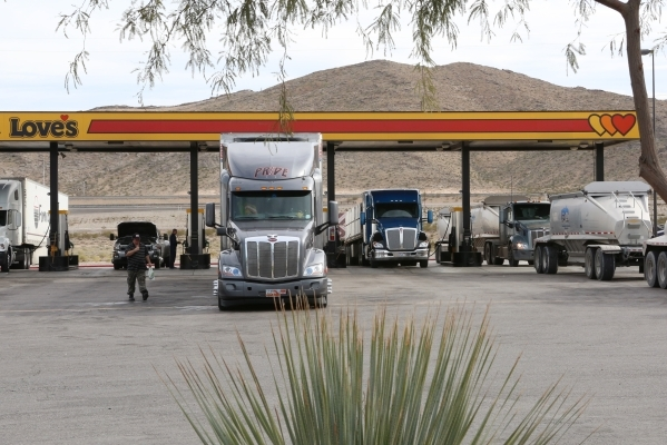 Truck drivers stop at a gas station at Love's Travel Stop at 12501 Apex Great Basin Way on Thursday, Dec. 10, 2015, near the site where Chinese-backed electric carmaker Faraday Future plans  ...