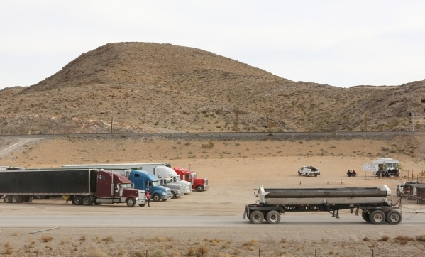 Trucks are parked on Thursday, Dec. 10, 2015, near the site where Chinese-backed electric carmaker Faraday Future plans to build a manufacturing plant at I-15/Highway 93 North junction in North La ...
