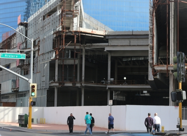 Pedestrians cross Riviera Boulevard in front of the still unfinished and uncovered Fontainebleau Resort in Las Vegas on Thursday, Dec. 10, 2015. Brett Le Blanc/Las Vegas Review-Journal Follow @ble ...