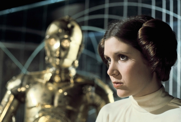 "C-3PO and Carrie Fisher appear in a scene from ""Star Wars."" (Courtesy of Lucasfilm)"