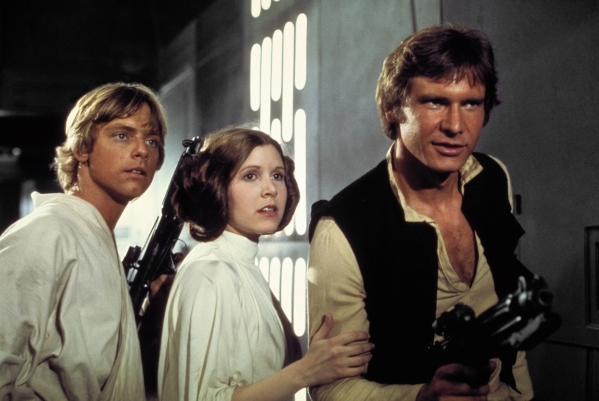 "From left, Mark Hamill, Carrie Fisher and Harrison Ford appear in a scene from ""Star Wars."" (Courtesy of Lucasfilm)"