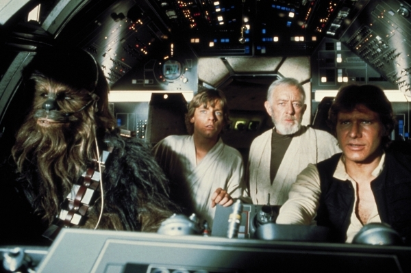 """From left, Chewbacca, Mark Hamill, Alec Guiness and Harrison Ford appear in a scene from """"Star Wars."""" (Courtesy of Lucasfilm)"""