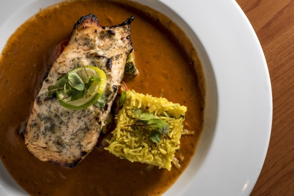 Tandoori Salmon, a dish with dill and mustard, broccoli and cauliflower, is presented with spiced ginger tomato sauce at Curry Leaf in Las Vegas on Saturday, Dec. 12, 2015. Joshua Dahl/Las Vegas R ...
