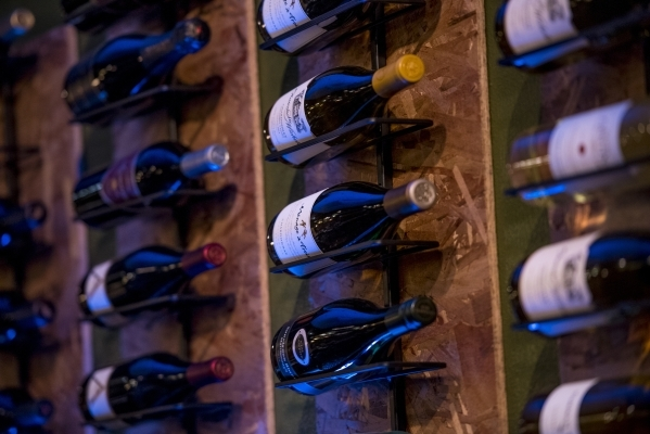 Wine bottles are displayed on the wall at Curry Leaf in Las Vegas on Saturday, Dec. 12, 2015. Joshua Dahl/Las Vegas Review-Journal