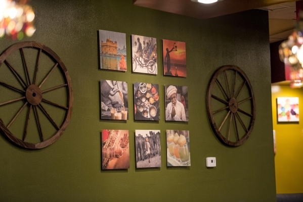 A grid of photos hangs on a wall in Curry Leaf in Las Vegas on Saturday, Dec. 12, 2015. Joshua Dahl/Las Vegas Review-Journal
