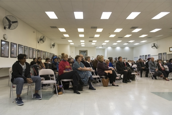 The audience listens local religious and community figures speak at Jamia Masjid Mosque during an interfaith prayer vigil to remember the victims and the family of the Dec. 2 mass shooting in San  ...