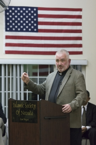 Father Bob Stoeckig speaks at Jamia Masjid Mosque during an interfaith prayer vigil to remember the victims and the family of the Dec. 2 mass shooting in San Bernardino, California in Las Vegas Su ...
